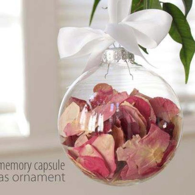 Save pedals from your wedding bouquet and put them in a Christmas ornament.