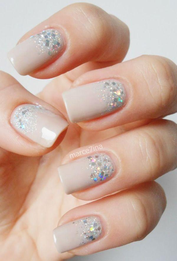 Half moon glitter nail art design in matte nude nail polish.