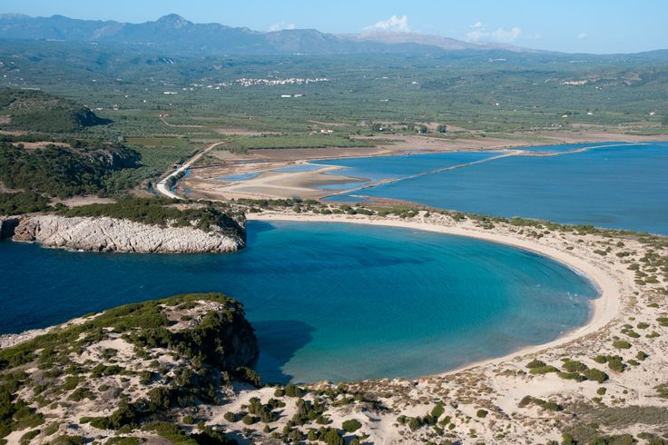 Voidokoilia Beach, Peloponnese: Photos of this beach in Messinia have gone viral. The white sand that surrounds the delicious blue-green water is such a perfect semicircle one suspects a draughtsman's hand. The unspoilt environment behind it, is yet another reason why this ranks among Greece's top ten beaches.