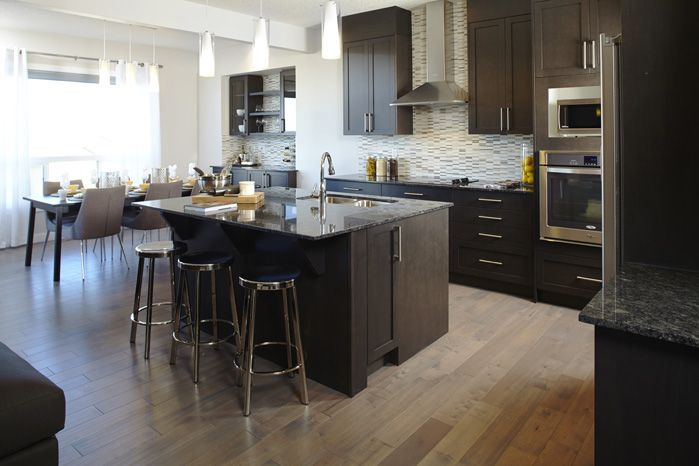 Kitchen / nook in the Tofino II showhome in Hillcrest in Airdrie by Shane Homes.