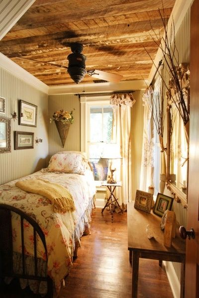 wood ceiling, beadboard walls, neutrals and prints