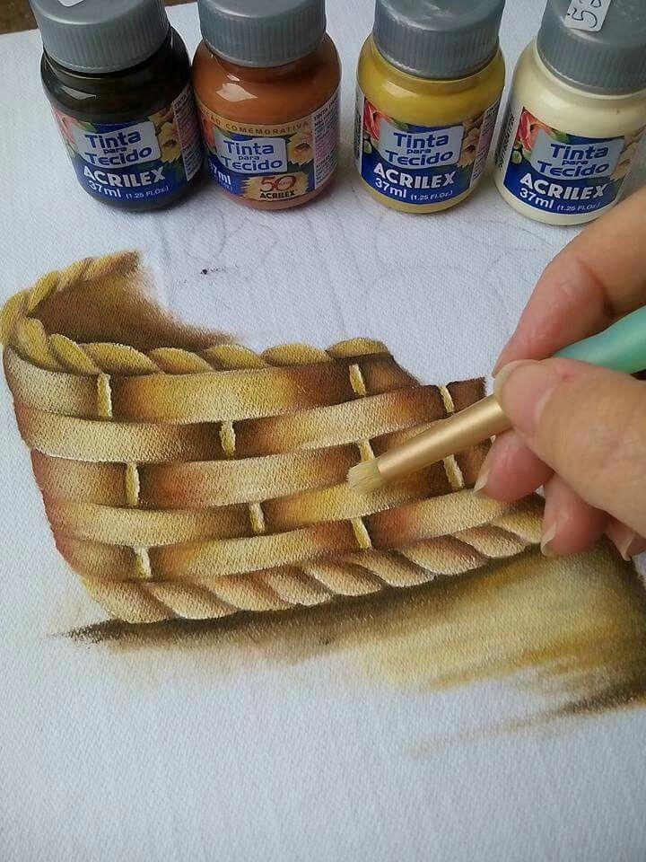 Pintando cesta.