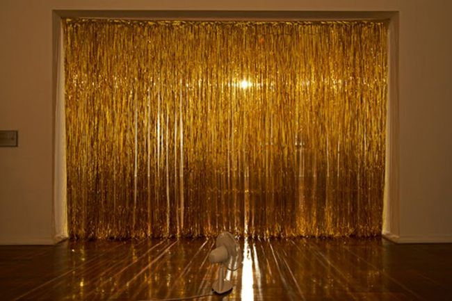 curtain of gold tinsel by rebecca baumann (video at link. love the . ... - Tinsel Curtain Backdrop ~ Decorate The House With Beautiful Curtains