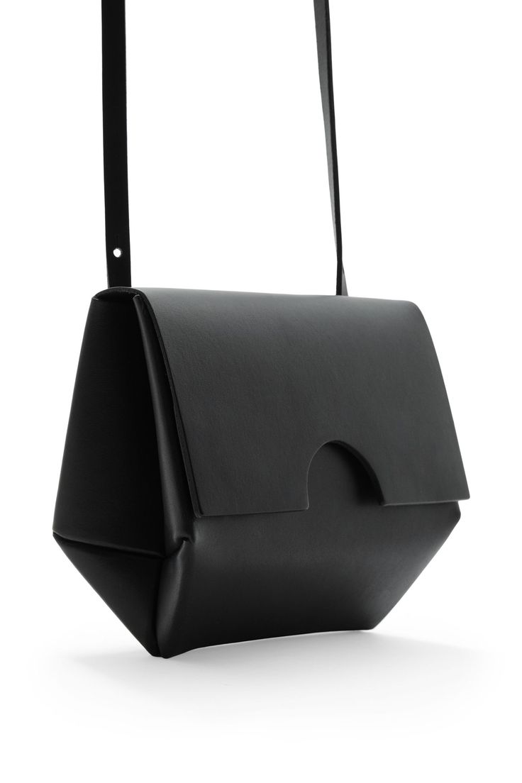 18 x 14 x 7cm This small constructed shoulder bag is made from raw-cut unlined leather. A minimal style, it has a flap-over front with hidden magnetic fastenings and a detachable strap.