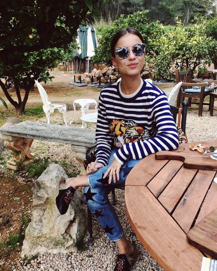 lizzy van der ligt wears a Gucci sweater in Ibiza