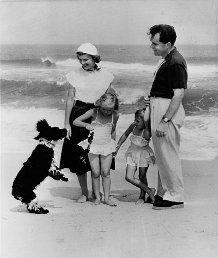 President Nixon and family with their famous pet Checkers.
