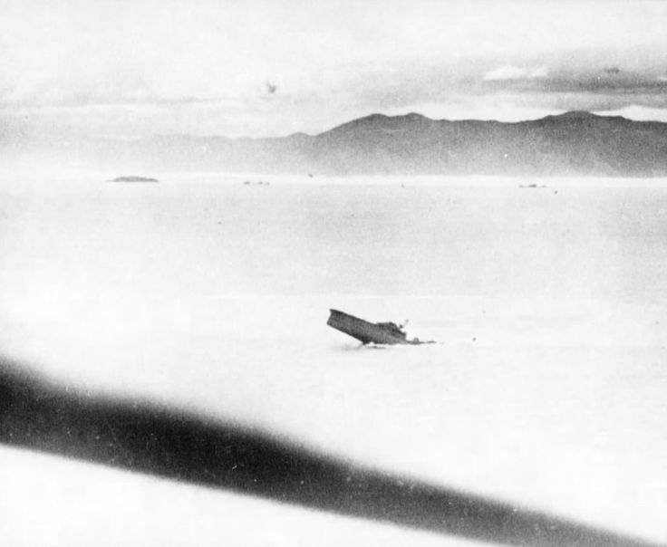 Japanese cruiser Kashii sinking by the stern after being attacked by United States carrier aircraft off the coast of French Indochina (Vietnam) north of Qui Nhon, Jan 12, 1945. Photo 6 of 8