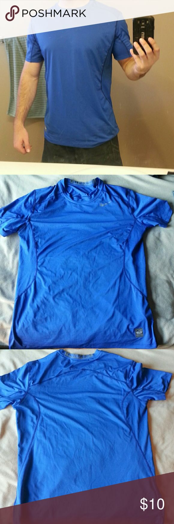 Nike pro combat blue shirt Size large, really stretchy material, slim fit but not tight, barely used, sitting in my dresser for a while Nike Shirts Tees - Short Sleeve