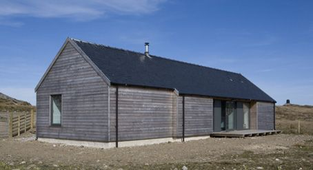 A building made with Larch Cladding showing how the cladding weathers to a silver grey colour