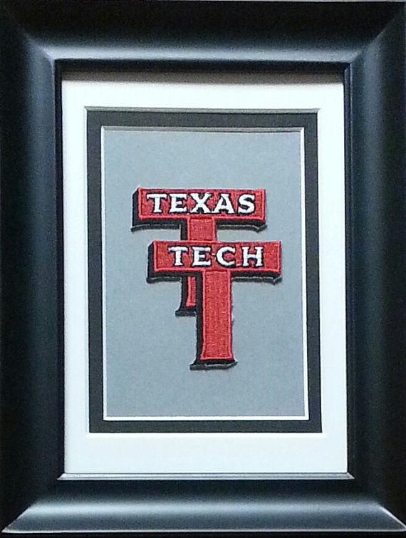 This is a vintage Texas Tech Red Raiders patch. Comes in a 6 1/4 x 8 1/4 black easel-back frame with 2-color mat and attached triangle hanger for wall mounting. #giftsforhim #vintage #dormdecor #texastech #texastechredraiders #redraiders