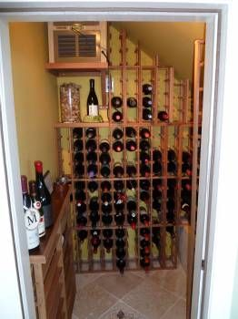 Under stairs wine cellar...this might cure my fear of the basement