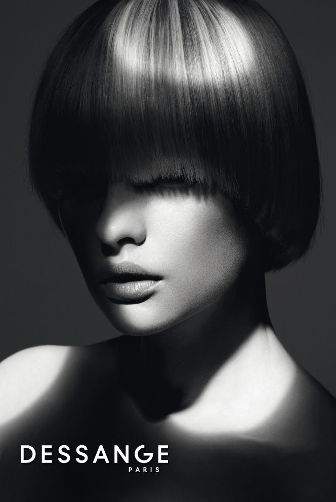 Short and minimal: A bob cut modernized by a straight style down to the ends. The ultra-smooth cut shows off jagged contours with blurred effects. Shiny hair intensely catches the light and reveals the contrast of a customized Color & Light balayage. #DESSANGE #Collection #FallWinter #LightOfShadows