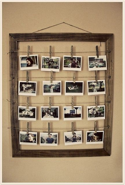 Display many photos with an old frame, wire, and clothespins. PERFECT use  for the huge frame I just took apart for the girls hair bow holder!