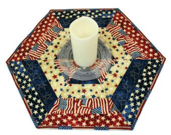 The festive design on this table topper would dress up any July 4th celebration.  https://www.etsy.com/market/quilted_table_topper/4