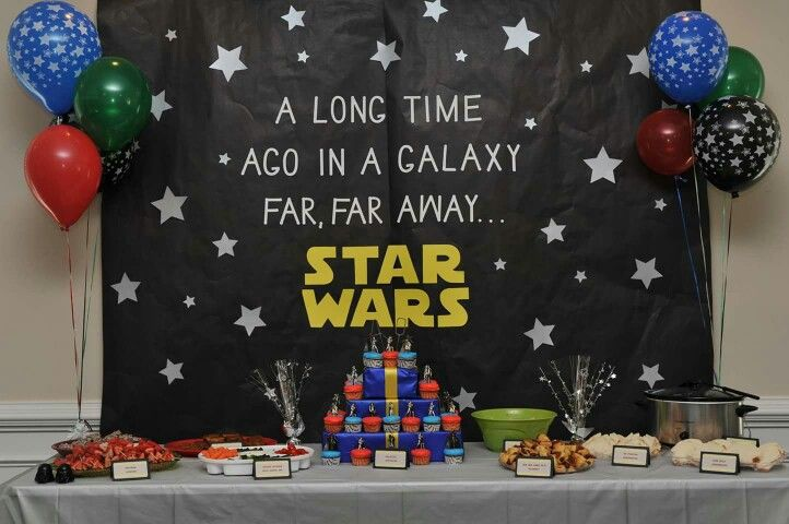 This was my husband's surprise 40th birthday party with a Star Wars theme, including the food! This was the backdrop I made and the main food table. The black paper is bulletin board paper and I cut the white letters out on a punch machine.