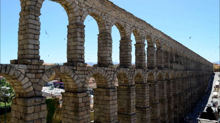 Aqueduct of Segovia. One of the most famous icon of the pass through the years in Spain, this monument was made by the Rome empire. Is a place which you have to visit if you came to Spain.