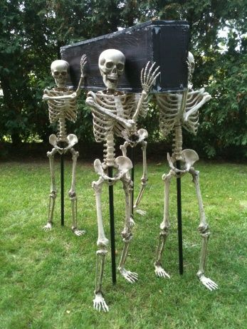 Styrofoam Coffin, 4 Walgreens Skeletons,   pvc pipes, rebar, Florist wire.  Clever!