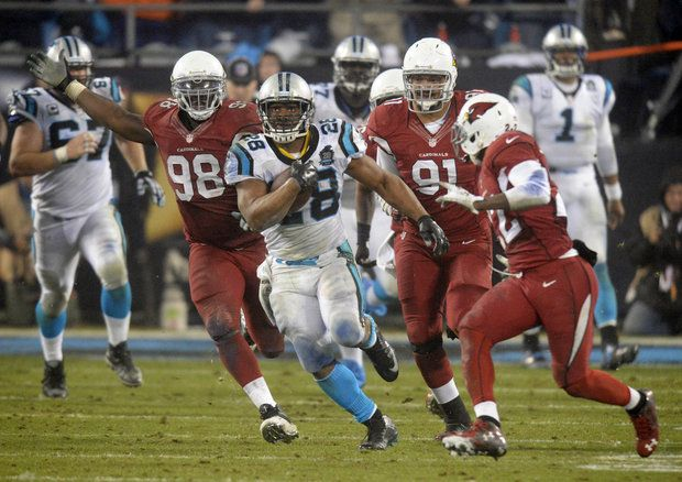 Carolina Panthers' Jonathan Stewart (28) breaks away from the Arizona Cardinals defense during the fourth quarter of their Wild Card NFL playoff game at Bank of America Stadium on Saturday, January 3, 2015. The Panthers won 27-16, and advance to the Divisional round.
