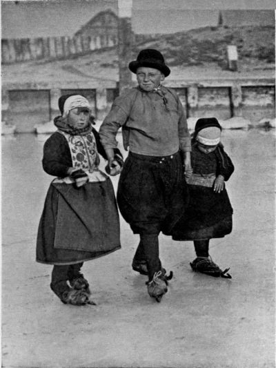 """♥Young """"Knickerbocker"""" and his sisters skating to school. In Holland everyone is as much at home on the ice as on land, and children learn to skate almost before they can walk"""