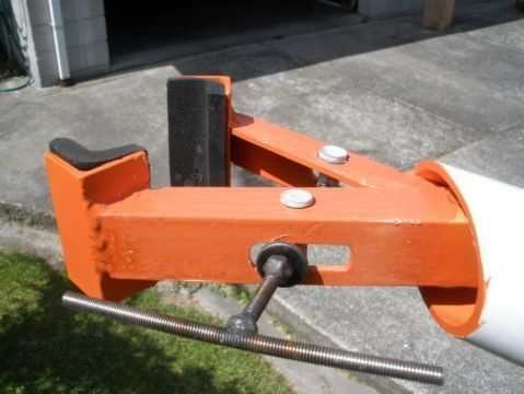 Bicycle Stand Clamp by  -- Homemade bicycle stand clamp constructed from angle iron, C-channel, threaded rod, and nuts. http://www.homemadetools.net/homemade-bicycle-stand-clamp-2