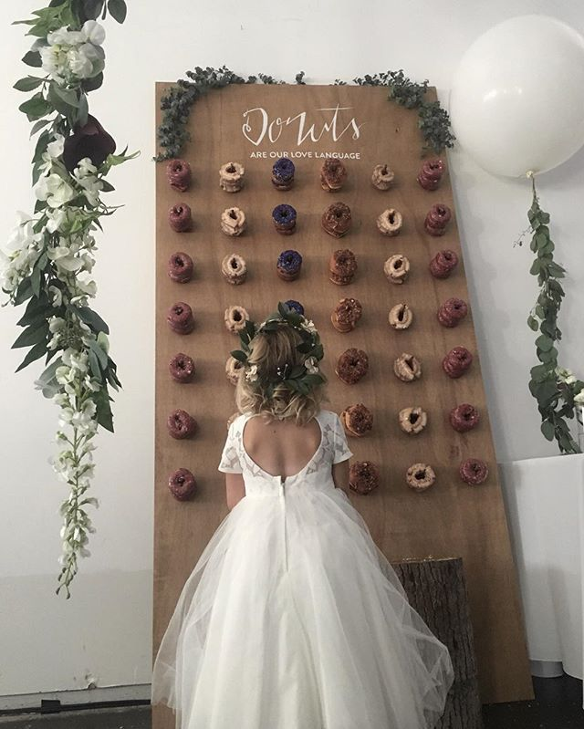 Your wedding dessert table needs a donut wall.