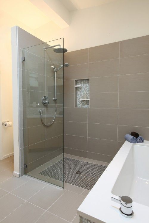 love this shower. Rain and hand held shower heads. Built in shelves and seat. Love the large tiles with mosiac glass tiles