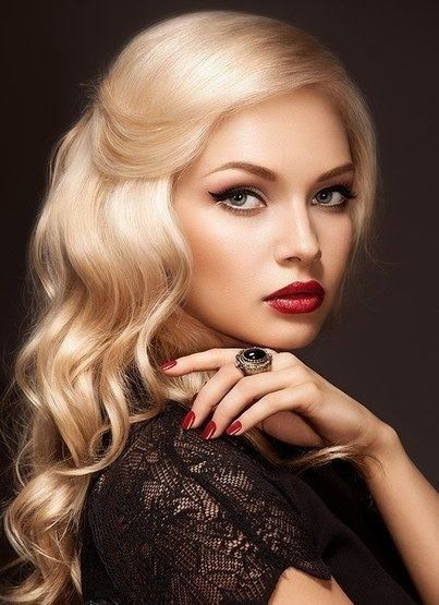 The 1950's curl + wing eyeliner (modernizes it) + the sultry and understated red lip= flawless face