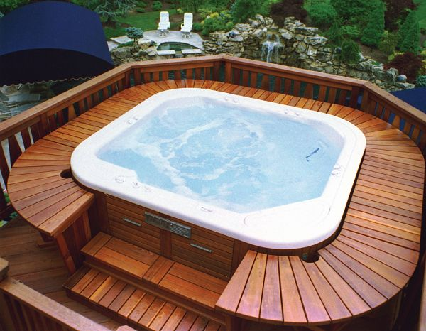 Wooden Bench Built Around A Hot Tub Extra Seating For
