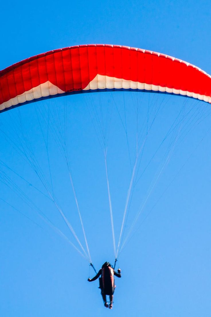 New free photo from Pexels: https://www.pexels.com/photo/person-using-red-parachute-on-mid-air-161179/ #man #person #sport