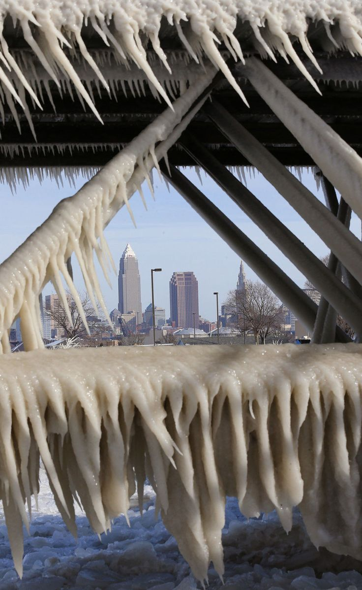 Cleveland is seen the the ice forming of the pier walkway at Edgewater Park in Cleveland, January 8, 2015. (John Kuntz / Northeast Ohio Media Group)