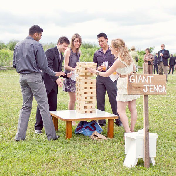 An oversized Jenga game is a cinch to create — all you need to do is take a trip to the hardware store for some lumber and have each cut to the same length (a traditional Jenga set uses 54 blocks).Photo Credit: Young Hearts Photography