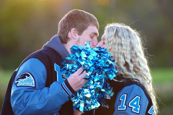 Senior athlete couple picture idea.... not big on couples in senior pics but for some reason this is really cute to me