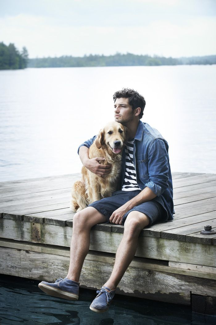 A well dressed man with his best-friend.  Nautical striped shirt, great shorts, denim shirt and a sweet pair of chuckas