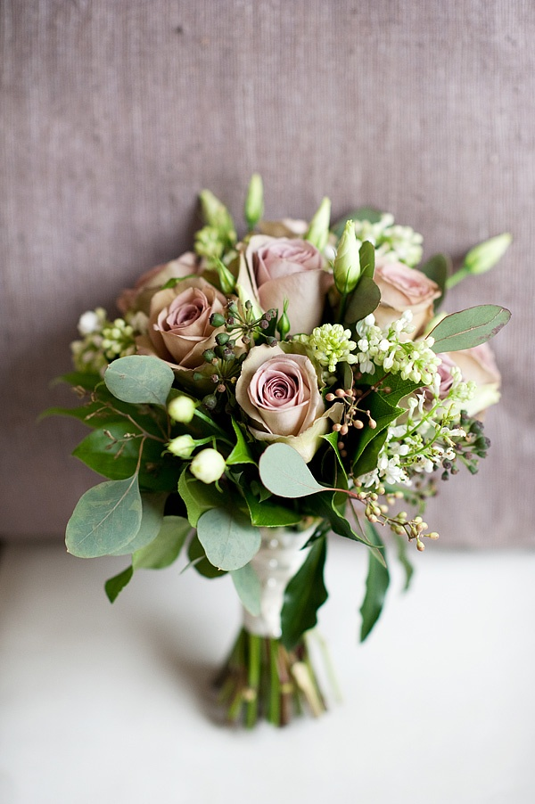 Nice example of bouquet shape - like this balance between a tight round bouquet but with a bit of looseness in the flowers and leaves.  Really like the inclusion of unopened buds as well as flowers.