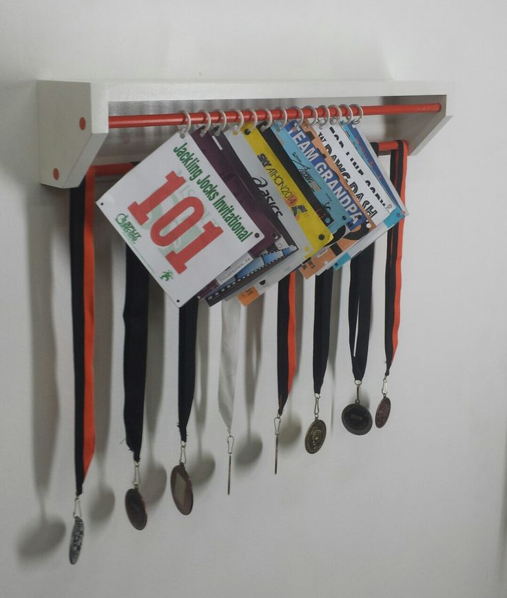 Trendy Running display for race bibs and medals-white and orange. race bibs holder, medal holder, running bibs display, running bib holder by TrendyDisplay on Etsy https://www.etsy.com/listing/229488699/trendy-running-display-for-race-bibs-and