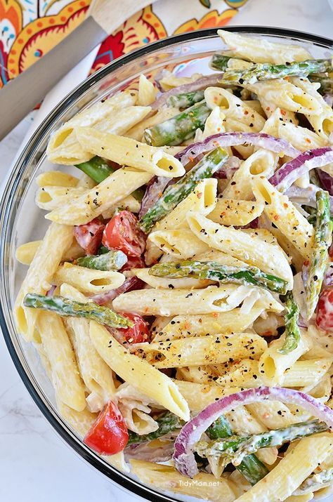 Creamy Asparagus Pasta Salad comes with an extra punch of flavor from fresh lemon juice and makes a perfect spring side dish. Add grilled chicken and it could be a meal all on it's own. Recipe at TidyMom.net