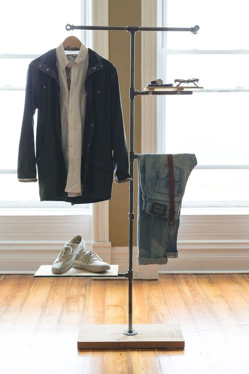 nice clothes valet... steel pipe and wood base... I will modify this idea, but I like it...