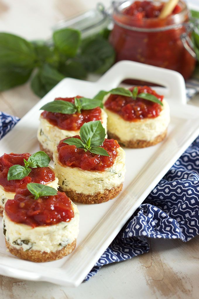 A savory spin on the classic cheesecake recipe, these savory mini Basil Parmesan Cheesecakes have a cracker crust and are topped with a tangy tomato jam. | @suburbansoapbox @darefoodsbetter