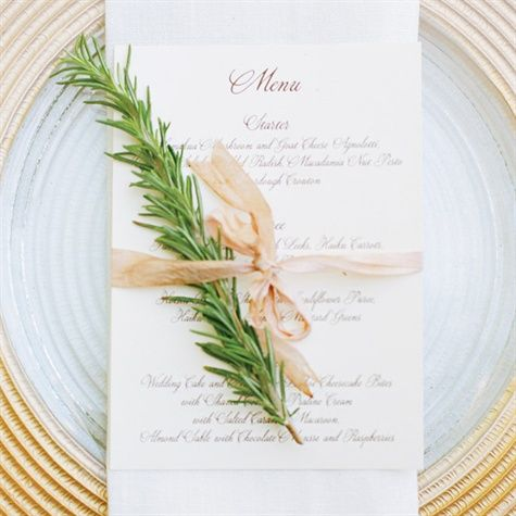 Menu card tied with a sprig of rosemary