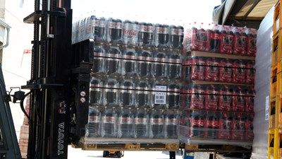 Coca-Cola palettes being loaded to a truck