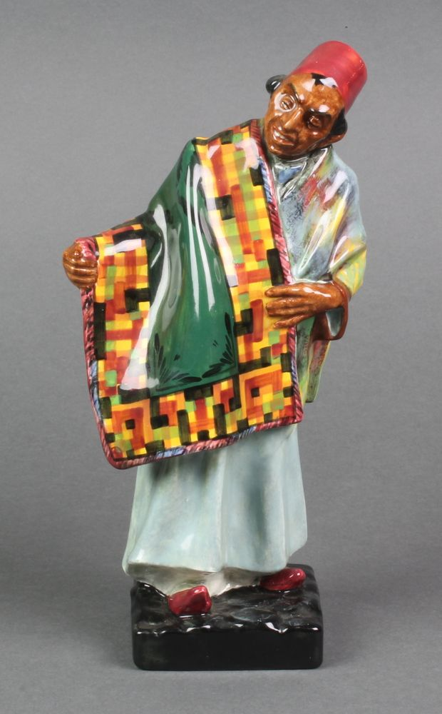 "Lot 1, A Royal Doulton figure - Carpet Seller HN1464 9"", sold for £40"
