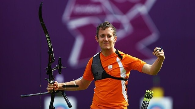 Rick van der Ven of Netherlands celebrates winning his men's Individual Archery 1/8 Eliminantions match against Im Dong Hyun of Korea during the Men's Individual Archery on Day 7 of the London 2012 Olympic Games at Lord's Cricket Ground