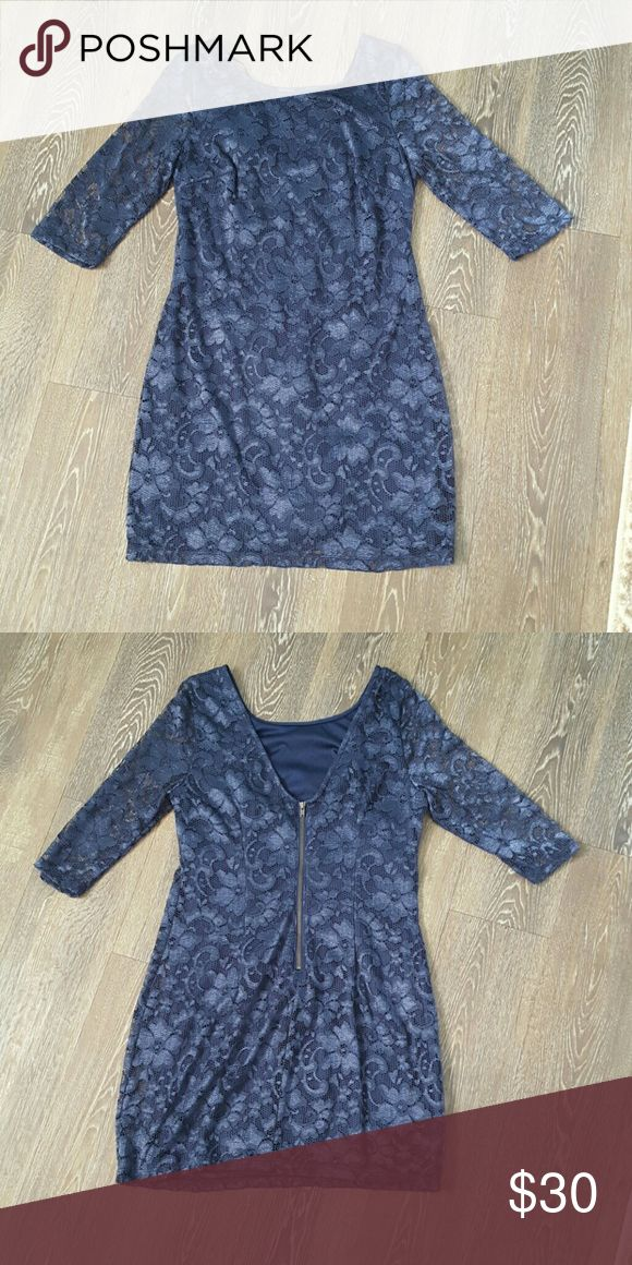 Navy Night Out Dress Navy with iridescent like flower embroidery. Back zipper, sleeves reach to elbow. Form fitting BCX Dresses