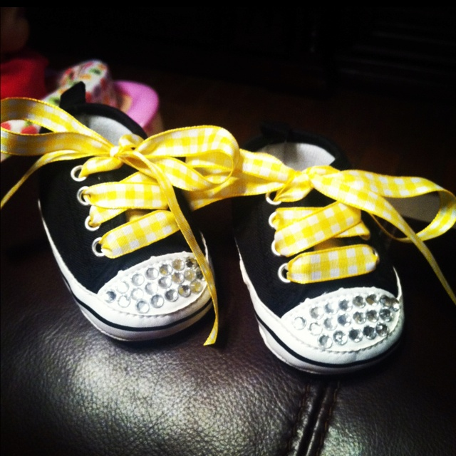 DIY baby tennis shoes! Plain tennis shoes $9.99 hobby lobby rhinestones with adhesive $2.99 and ribbon of your choice! Can mix and match for different occasions!