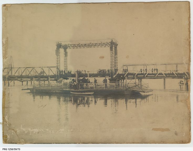 Swan Hill Bridge (opened 1896)with raised centre section and adjacent pontoon (W/2), Swan Hill punt in the foreground