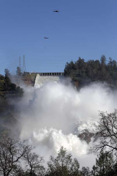Dramatic new images show scale of damage to Oroville Dam spillway -  February 28, 2017:    Helicopters continue to stabilize the emergency spillway next to the main Oroville Dam spillway as water is released on Tuesday Feb. 14,  2017, in Oroville, Ca.