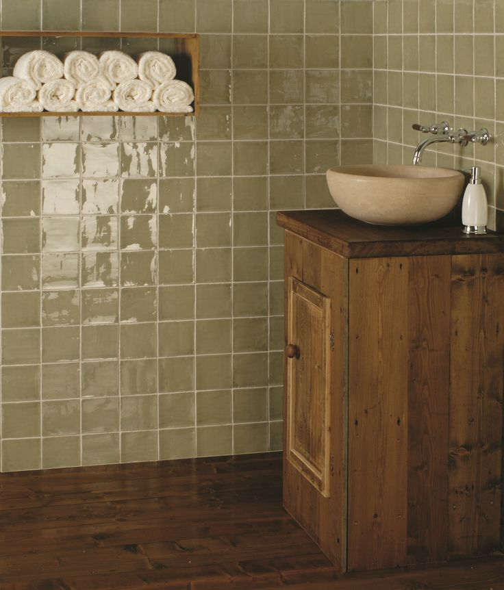 Sedge feature a sage green hue, creating a soothing atmosphere wherever they are used. The subtle crackled effect that occurs naturally when fired in the kiln. This gives a sense of antiquity that is rather charming. Handmade ceramic tiles, made in the UK. winchestertiles.com