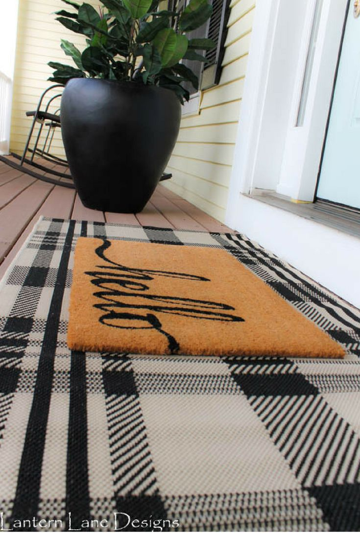 Updating your front porch on a budget. Plaid rug from Amazon