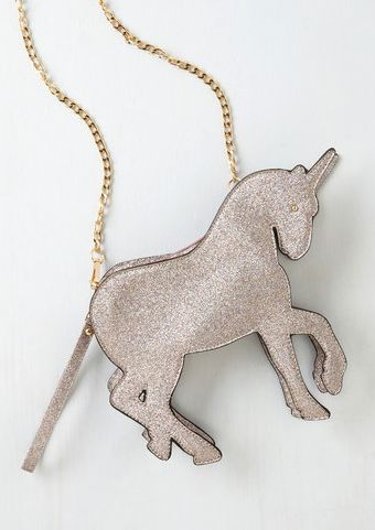 "This glittery unicorn <a href=""http://www.modcloth.com/shop/handbags/champing-at-the-glitz-bag"" target=""_blank"">bag</a>:"