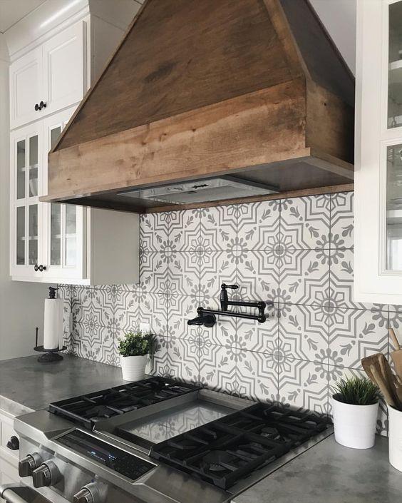 Patterned Tile Backsplash With Rustic Wood Range Hood Farmhouse Kitchen Backsplash Kitchen Countertop Materials Modern Farmhouse Kitchens
